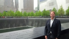 Kent Swig in front of Reflecting Absence pool
