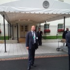 Kent Swig at the entrance to The White House