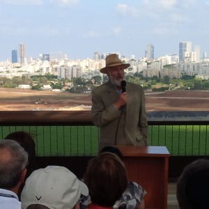 Martin Weill, addressing the Israel Bond delegation overlooking the Ariel Sharon Park being developed in the background.