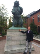 Kent Swig in front of the statute of the Brown Bear, located on the Main Green of campus.