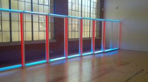 A work by Dan Flavin against the back drop of the former industrial building in Beacon.